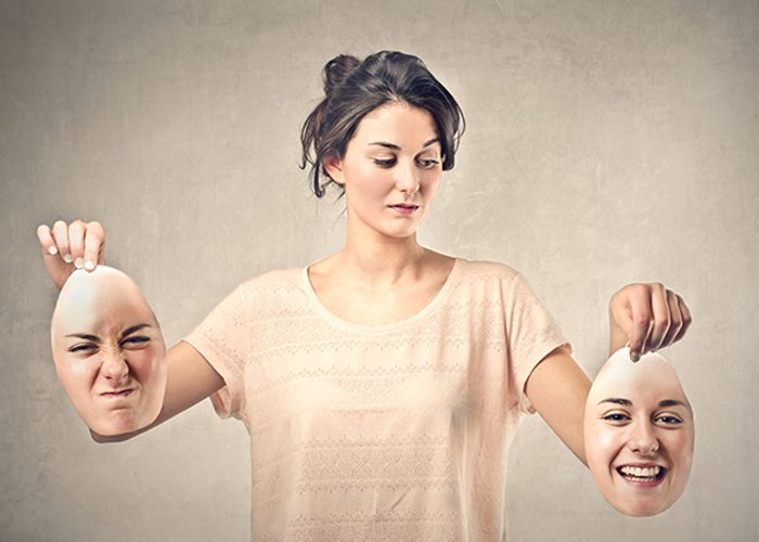Woman with impostor syndrome holding two different masks