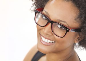 African american woman with glasses smiling