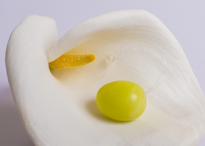 Golden yellow yoni egg on white lower