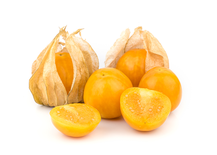 Close up of two golden berries in their husks, two open berries, and one halved golden berry on a white surface.