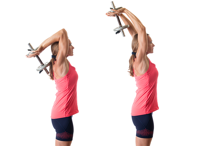 Woman performing a tricep extension as part of chest and triceps workout