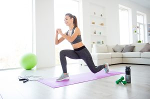 woman doing calisthenics workout in her home