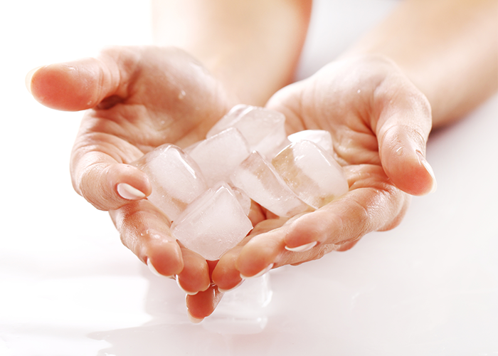 Woman holding a pile of ice in her hands