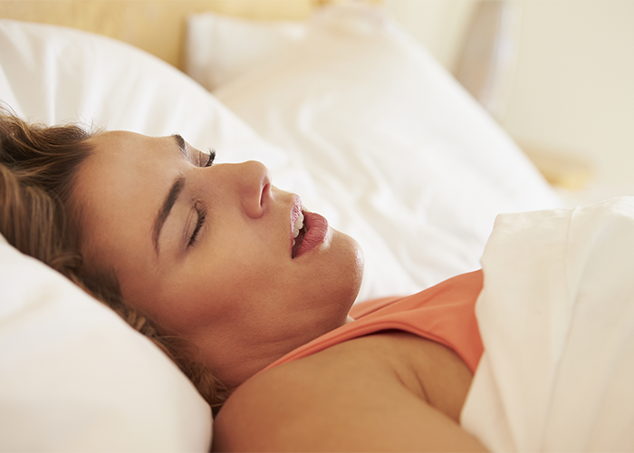 Close up of sleeping woman with mouth open.