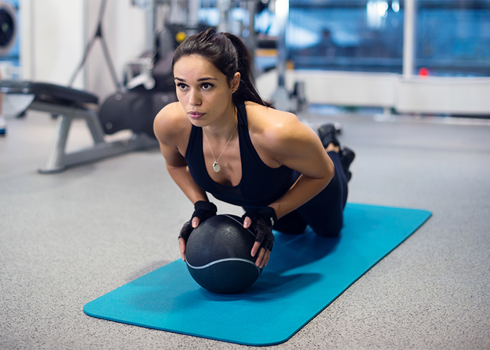 woman doing push ups for chest and triceps workout