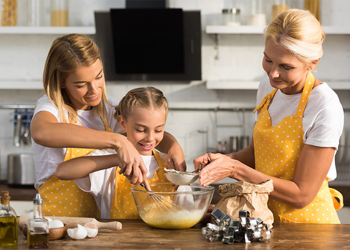 Three generations of women spending time together baking