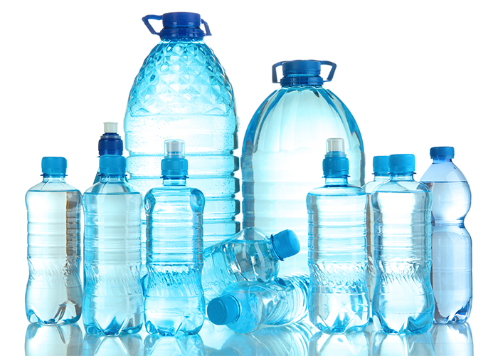 Different sized bottles of distilled vs purified water