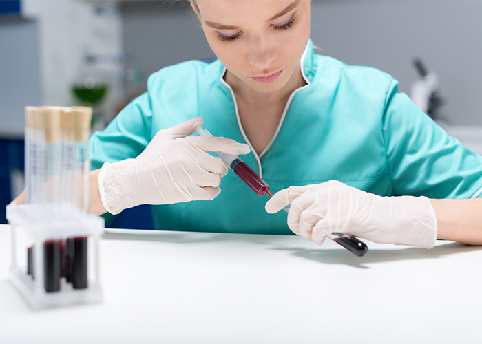 Female lab technician working with blood samples