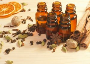 Five bottles of anise black pepper essential oil blend