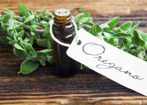 Bottle of oregano essential oil for use on skin tags