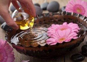 Essential oil blend being poured in a water bowl