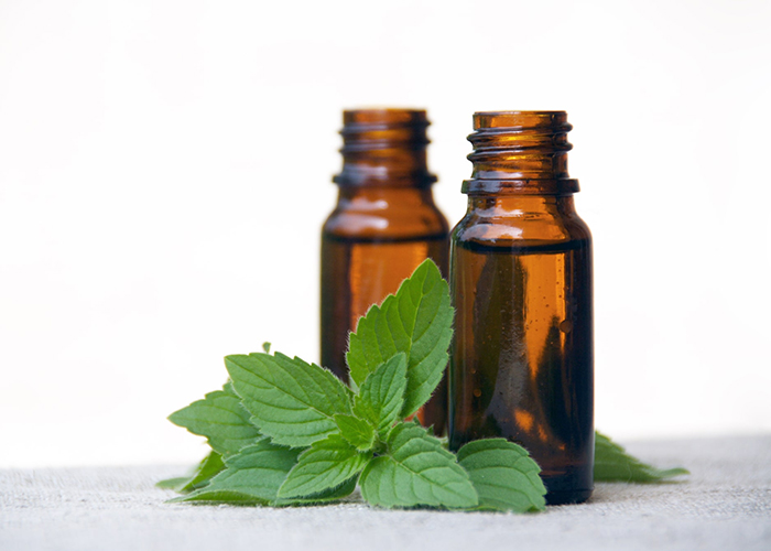 Two bottles of eucalyptus tea tree and peppermint essential oil blends for sunburn