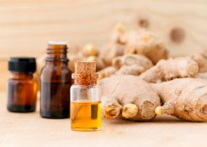 Bottles of anise essential oil blended with ginger essential oil