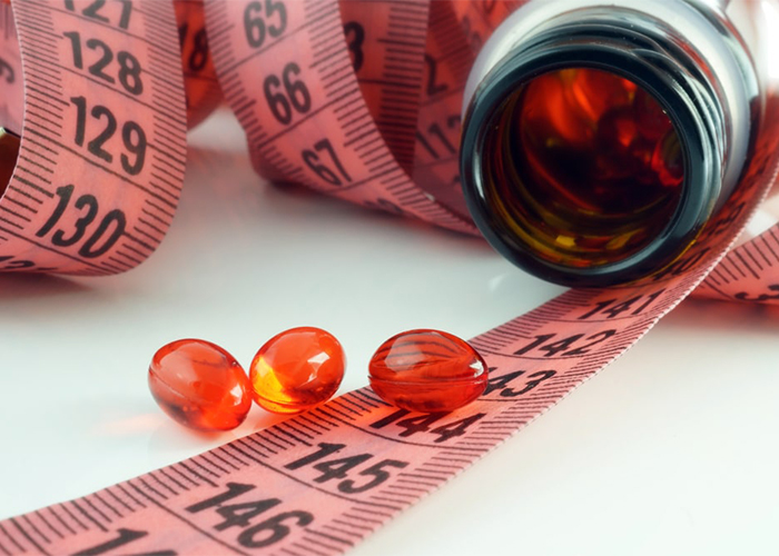 Keto weight loss pills for weight loss on a tape measure