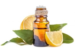 A bottle of lemon essential oil designed to dehydrate skin tags