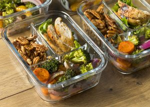 Keto meal prep containers filled with keto-approved foods