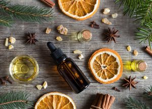 Flat lay featuring orange and anise essential oil blend