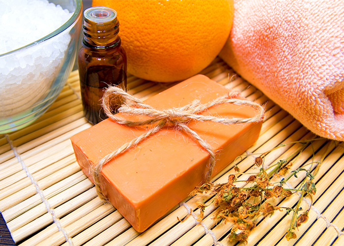 A homemade orange essential oil disinfecting soap bar