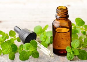 A bottle of oregano essential oil with a dropper