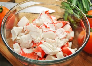 Pieces of processed crab in a bowl