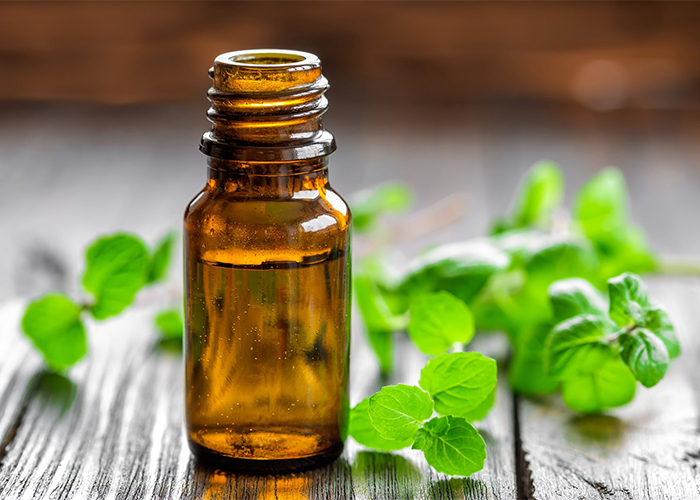 A bottle of lavender essential oil blended with peppermint essential oil
