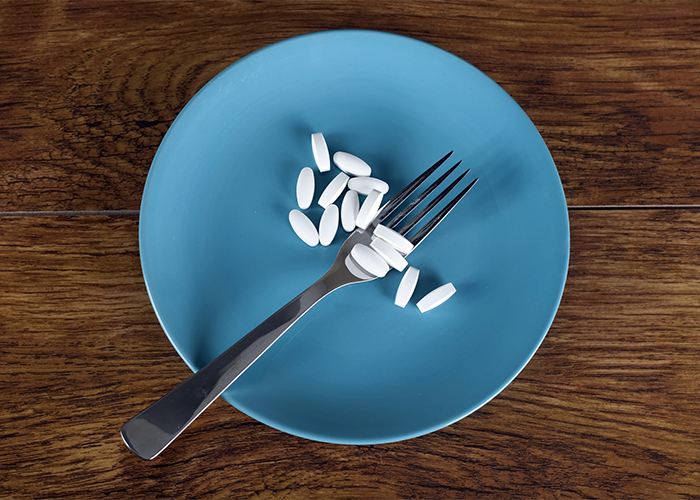 A plate filled with keto diet pills