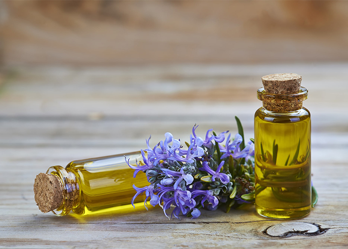 Two vials of lavender and rosemary essential oil blends