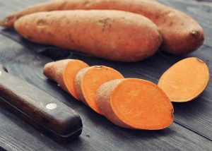 Whole and chopped sweet potatoes