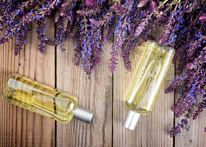Two bottles of tea tree and clary sage essential oil blends for acne