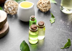 Three bottles of tea tree essential oils which are made for acne relief