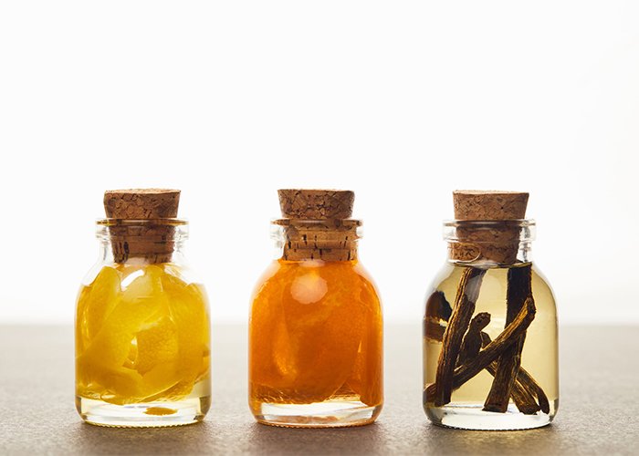 Vanilla, lemon, and orange essential oils blends in bottles