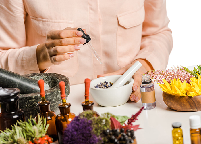 Woman making her own essential oil blends at home