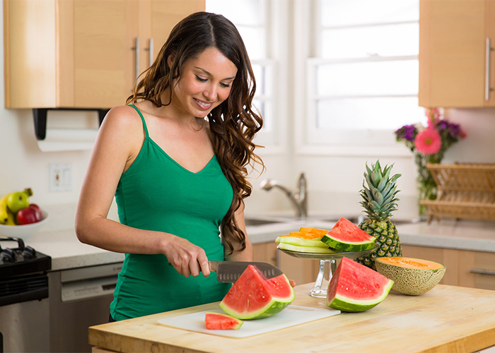 Woman on Paleo diet eating watermelon