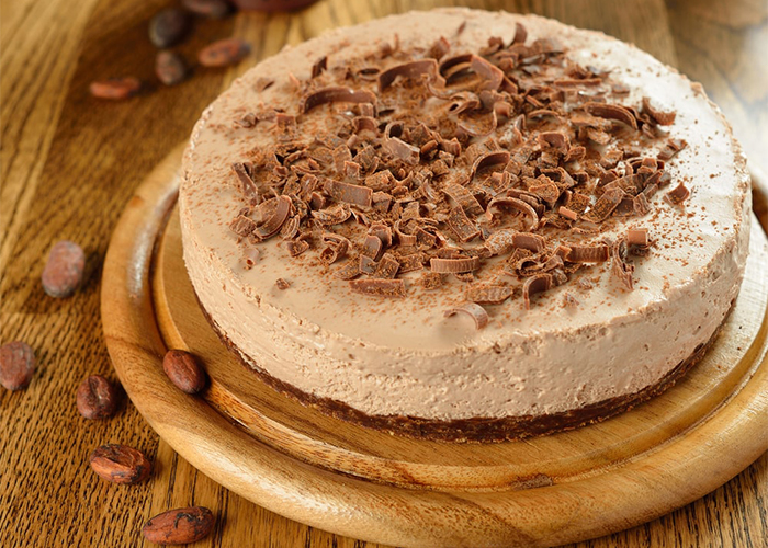Whole cocoa Paleo cheesecake topped with dark chocolate shavings