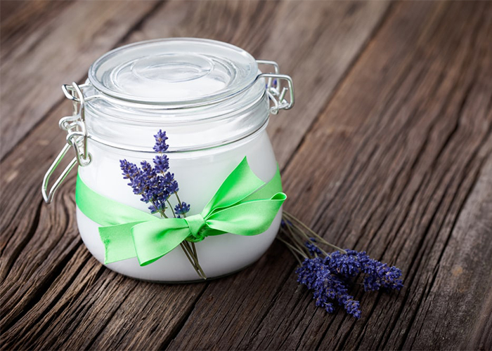 A homemade jar of coconut oil and lavender essential oil lotion