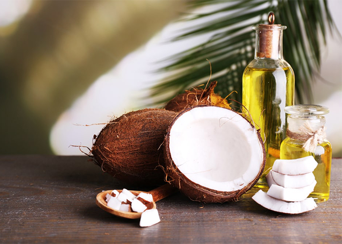 fresh coconuts and bottles of coconut oil