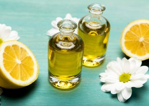Two bottles of lemon essential oil and chamomile for use in skin moisturizers