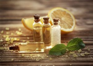 Vials of lemon essential oil on a wooden board