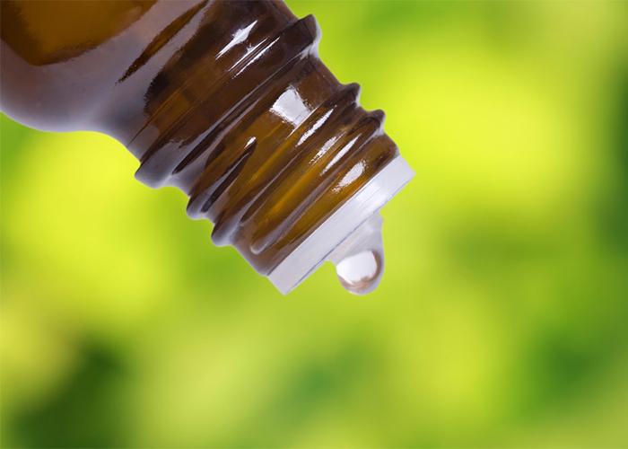 Closeup of coconut oil being dropped