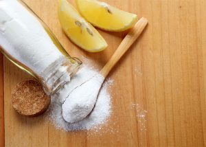 Ingredients for a homemade spot treatment with lemon essential oil.