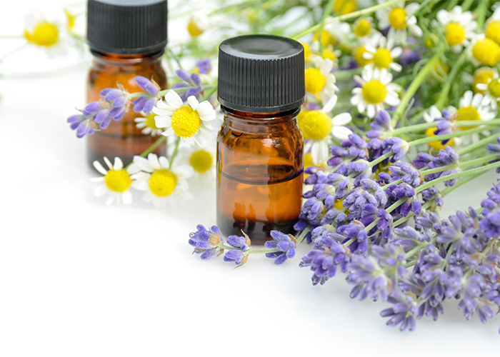 Bottle of Serenity essential oil blend with chamomile, lavender, and frankincense oils.