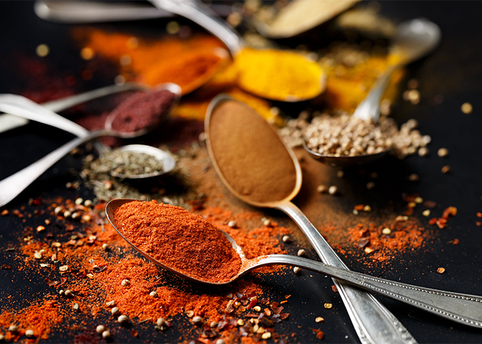 Spoons filled with different spices