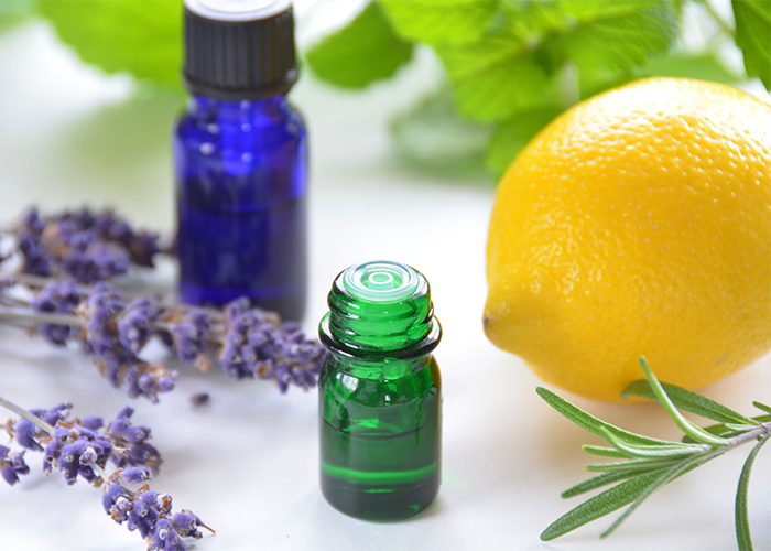 Homemade essential oils acne face toner with tea tree, lemon, and lavender essential oils, plus witch hazel