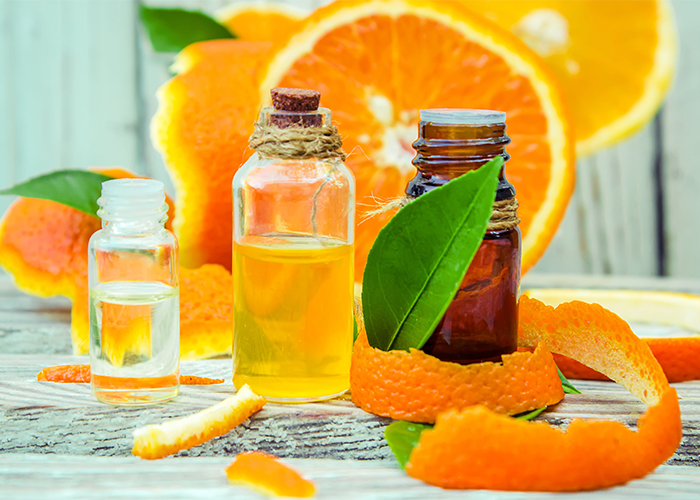 Homemade orange and sandalwood essential oils anti-inflammation spot treatment