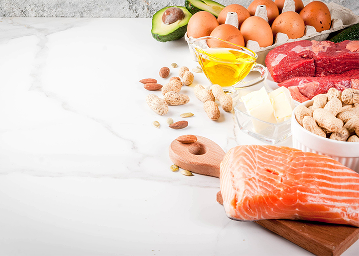 Different kinds of healthy fats on the Keto diet including eggs, red meat,fish, and nuts