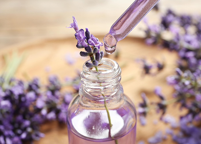 A dropper being used to make homemade lavender essential oil