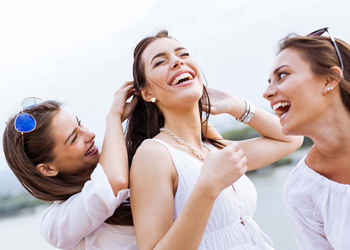 Three women having a great time and laughing