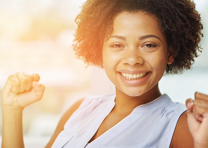 Woman smiling proudly due to her success on the AIP diet