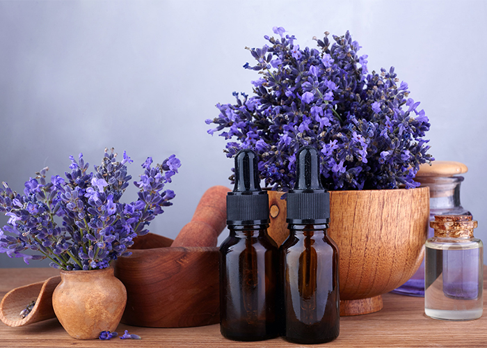 essential-oil-and-lavender-flowers-on-wooden-table