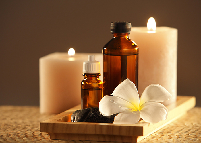 Essential oils and lit candles for sleep  and aromatherapy